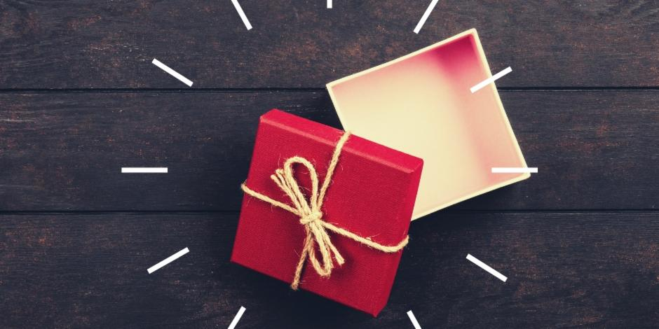 Opened Gift box with a wooden background